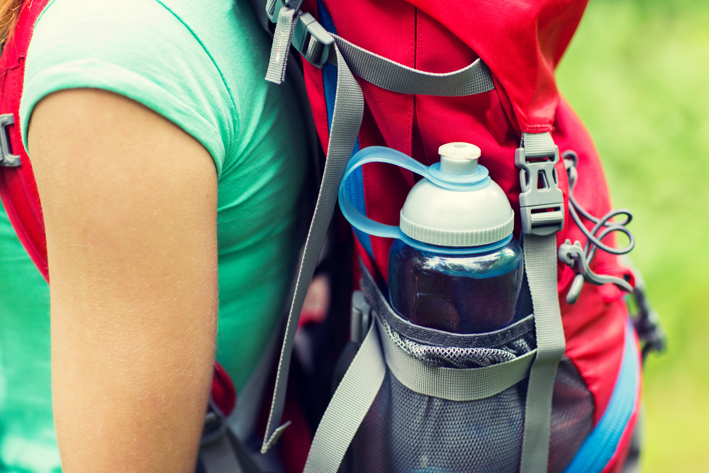 woman with water bottle backpack
