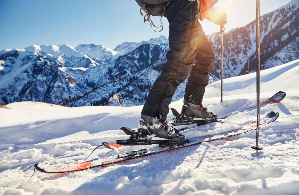 man skiing on powder fresh