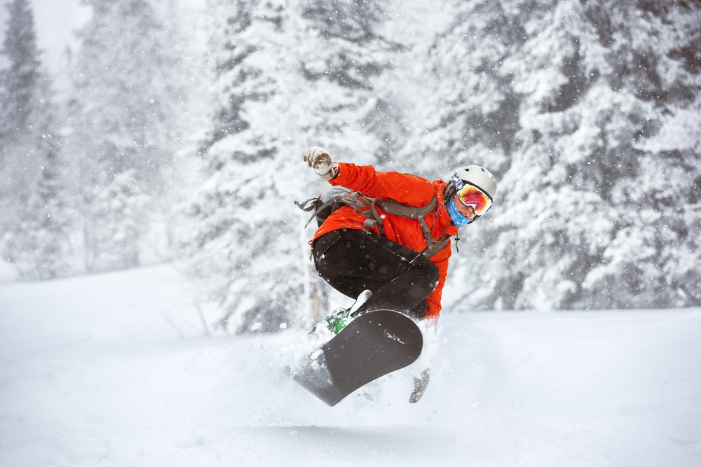 snow boarder jumps
