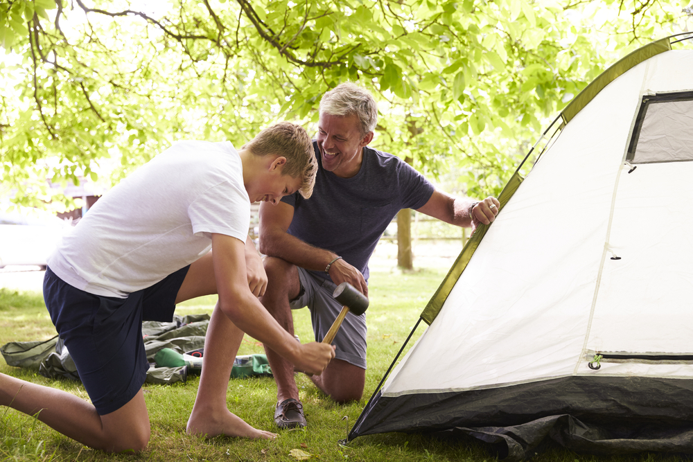 father son putting up tent