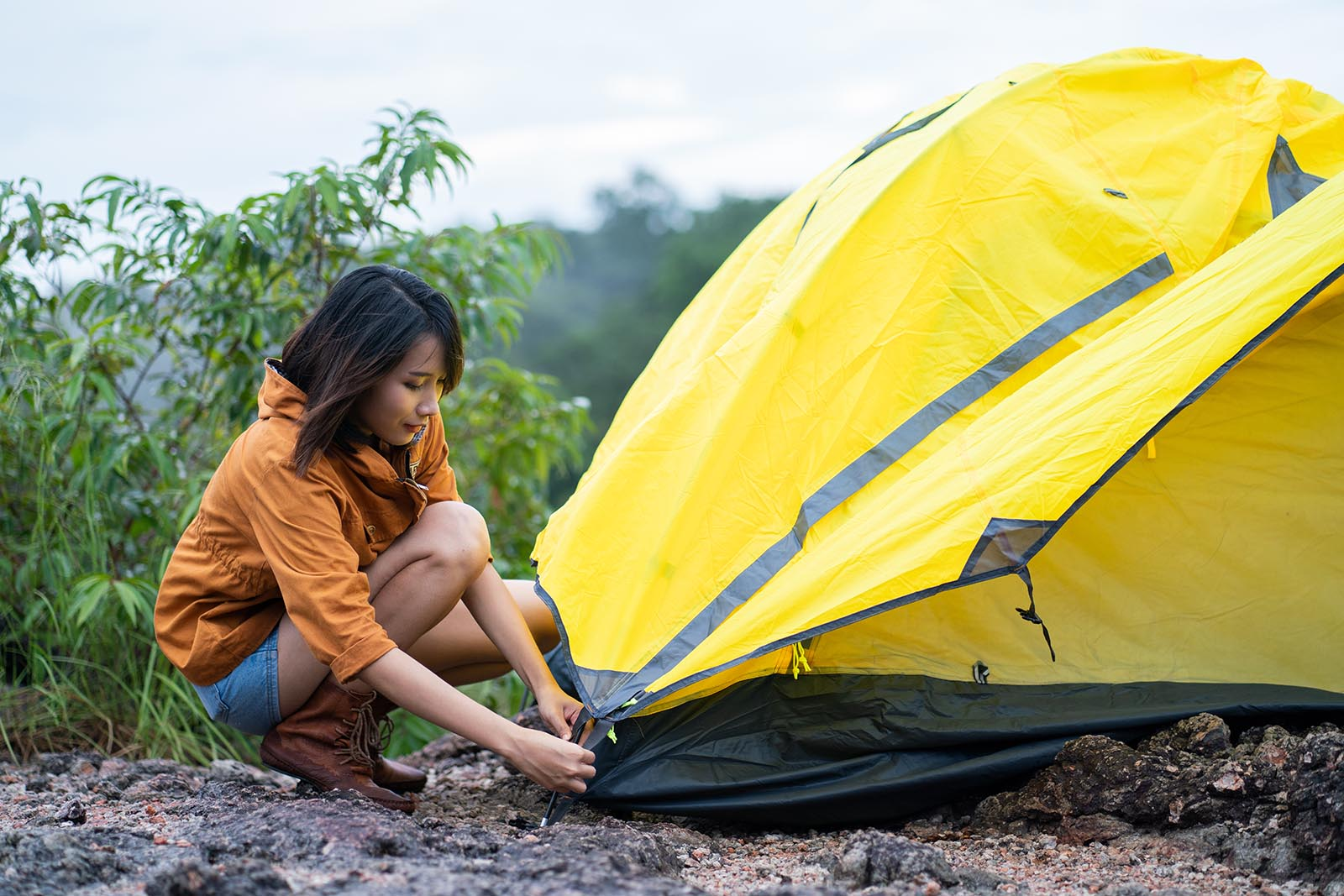 woman anchoring tent