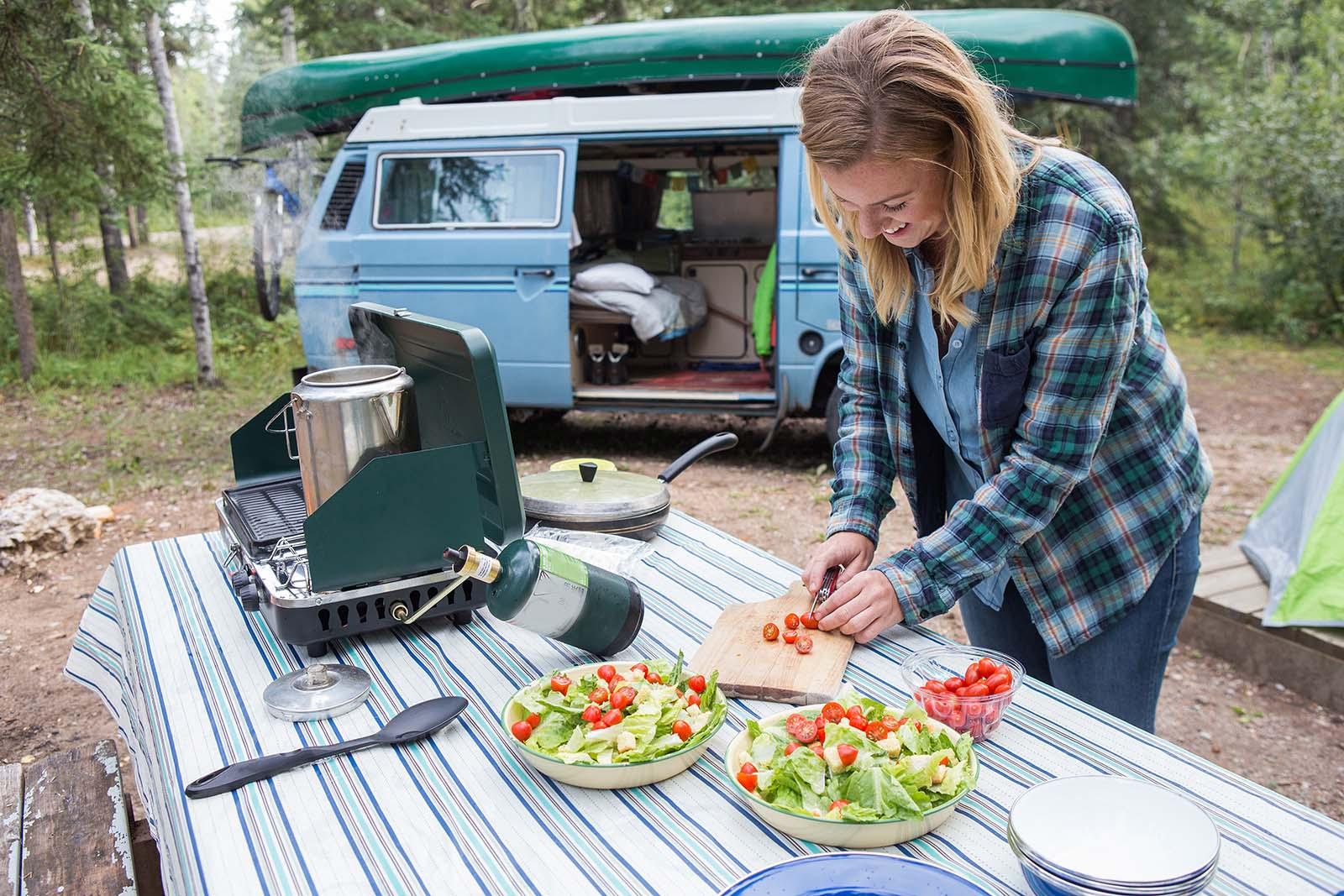 woman preparing food campsite